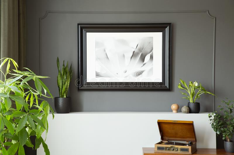 Close-up of a wall with a painting in a black frame stock images