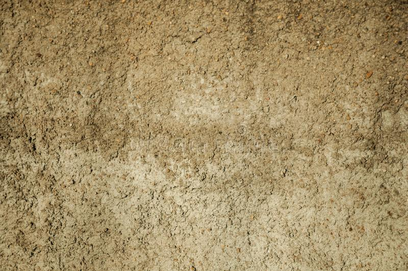 Close-up of wall with rough plaster and gravel inserted on it. Close-up of wall with rough plaster and small gravel inserted on it, making a quaint background royalty free stock photography