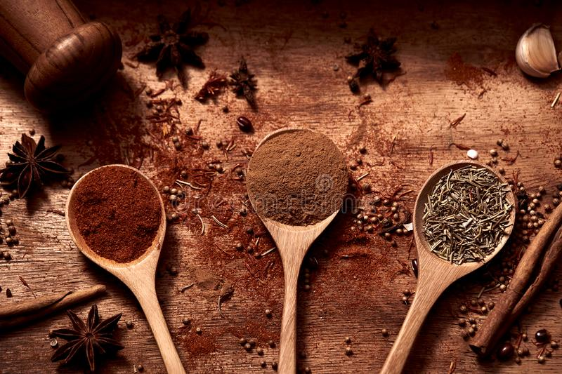 Close up of warm colorful various spices and herbs with pepper shaker stock photo