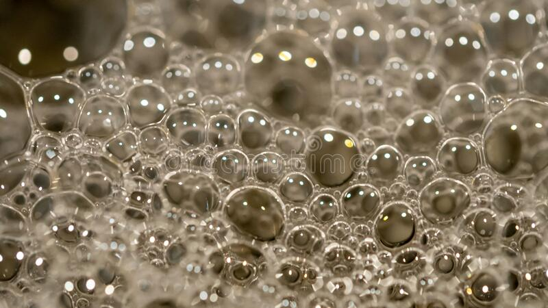A close up of washing detergent bubbles at home in adelaide south australia on 1st February 2020 royalty free stock photos