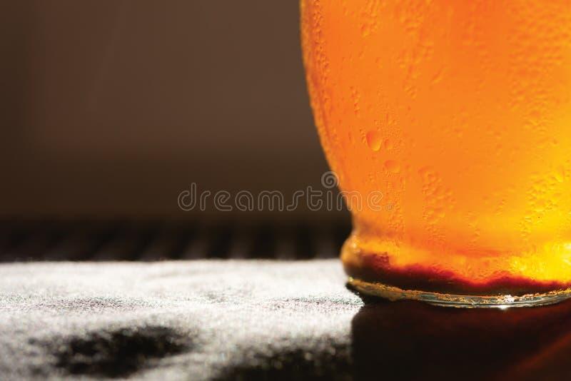 Close up water drops on orange juice bottle royalty free stock image