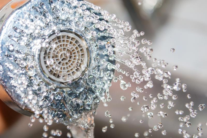 Close up water flowing out from sink shower in kitchen stock image