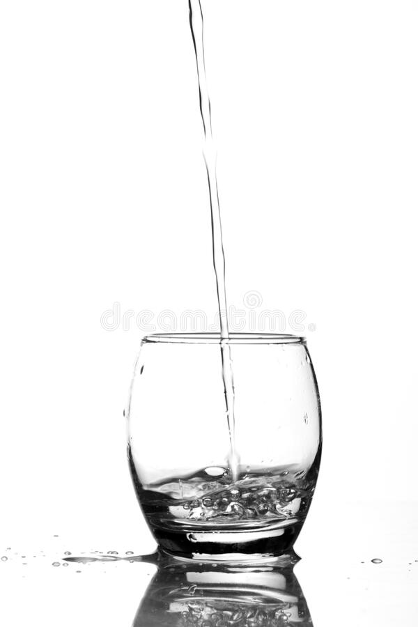 Close-up of Water Pouring in Glass royalty free stock image