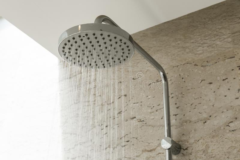 Close up of water shower faucet in the bathroom royalty free stock photo