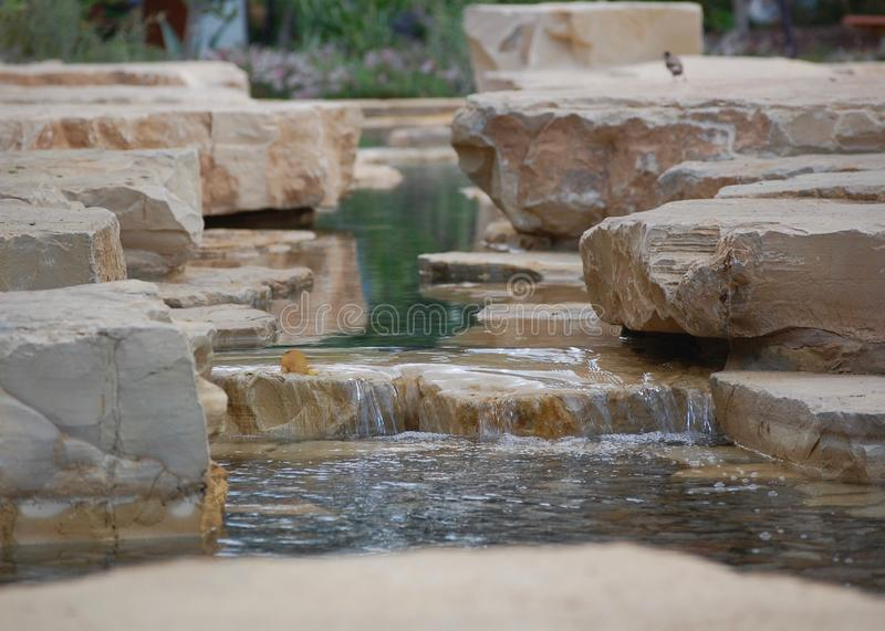 Close up waterfall with calm background. A close up shot of a waterfall that is soothing, calm, and small. Taken in Abu Dhabi, UAE stock photography
