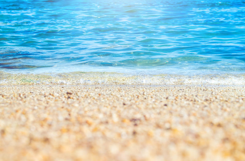Close up wave of blue sea on sand beach seashore,nature background,summer time,selective focus on wave stock photography