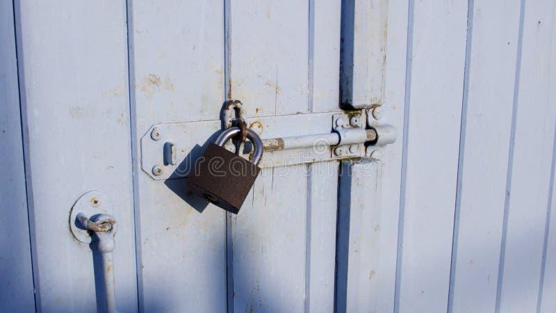 Pad-locked fisherman`s quayside store room door stock photos