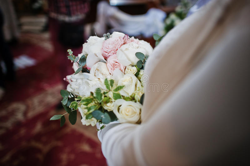 Close up wedding bouquet at hand of bridesmaid.  stock photos