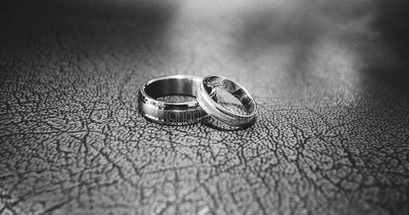 Close-up of Wedding Rings on Floor royalty free stock photography