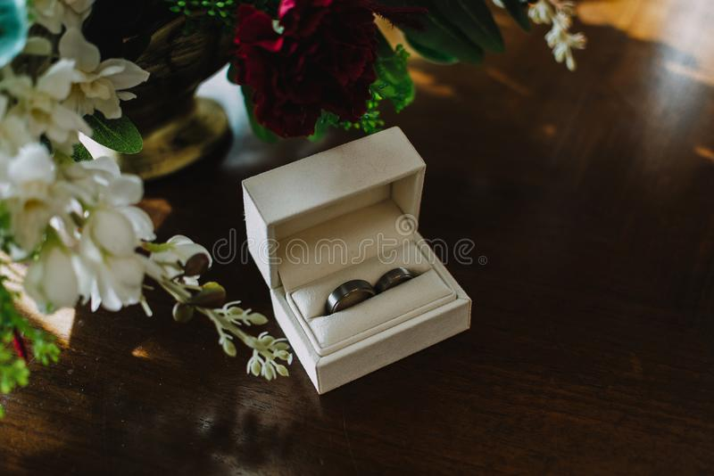 Close up on wedding rings on the table stock image