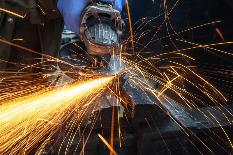 A close-up the welder cuts the metal royalty free stock image