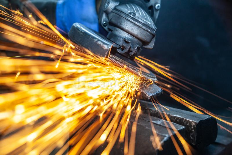 A close-up the welder cuts the metal stock photos