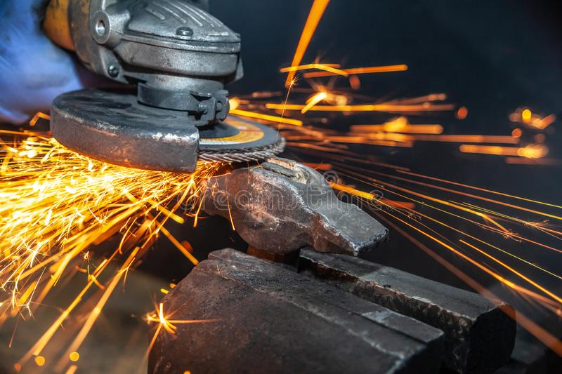 A close-up the welder cuts the metal stock image