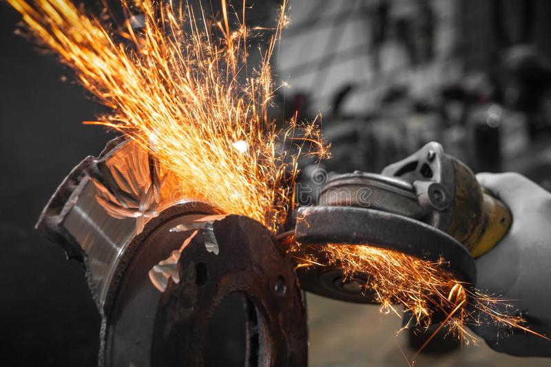 A close-up the welder cuts the metal stock photography