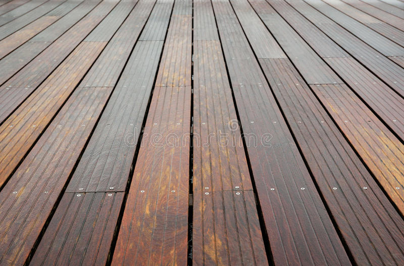 Close-up of the wet wooden flooring. The wet planks of the batten platform are photographed with diminishing perspective royalty free stock photos