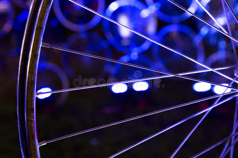 Close-up of a wheel of bike. A wheel of a bike in blue light royalty free stock photo