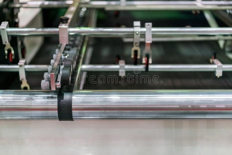Close up wheel and roller for paper feeder unit of modern and high technology of automatic publication or printing machine stock photo