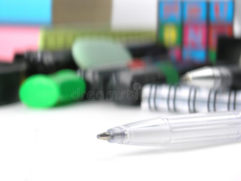 Close up.white ball point pen on the background of school supplies.  stock photography