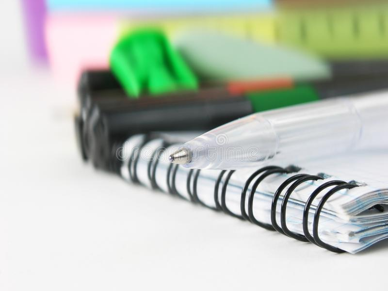 Close up.white ball point pen on the notebook .photo with copy space.  royalty free stock photo