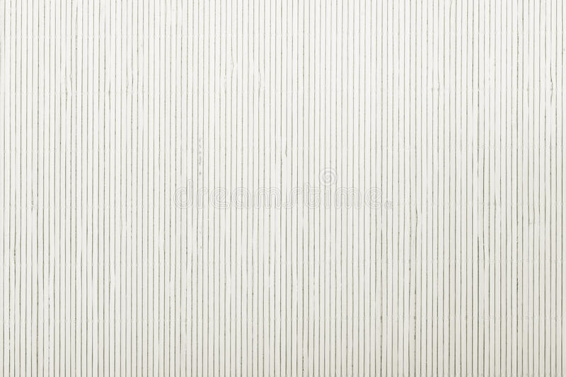 Close up white bamboo mat striped background texture pattern. Close up macro of white bamboo mat as striped background texture pattern. Oriental royalty free stock photography