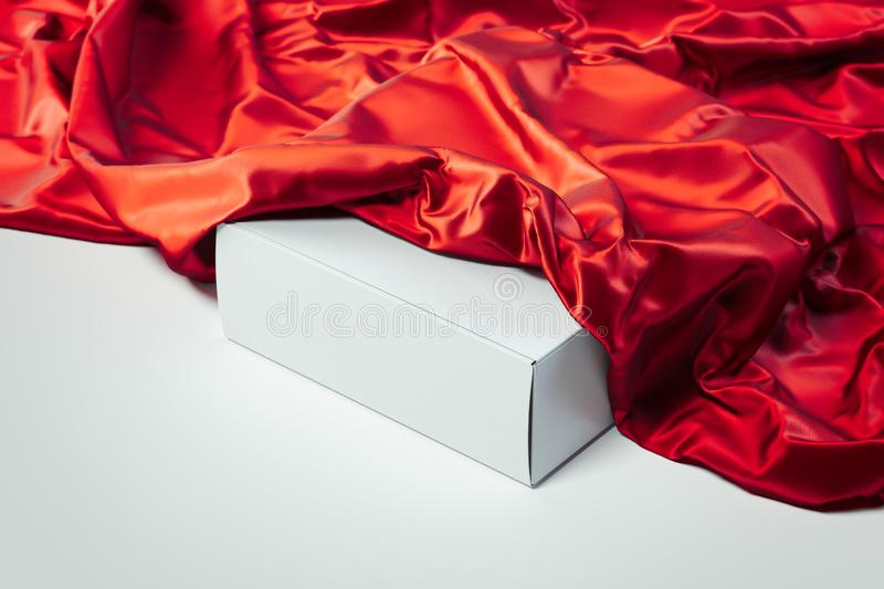 Close up of white blank box under red cloth on white background. 3d rendering. stock illustration