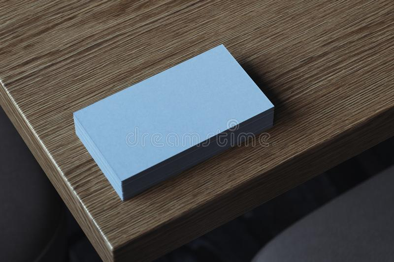 Close up of white blank illuminated by daylight business cards set on wooden table, 3d rendering. vector illustration