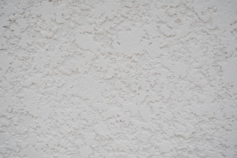 Close up of White cement or concrete wall background texture, free space for design text or pictures stock photography
