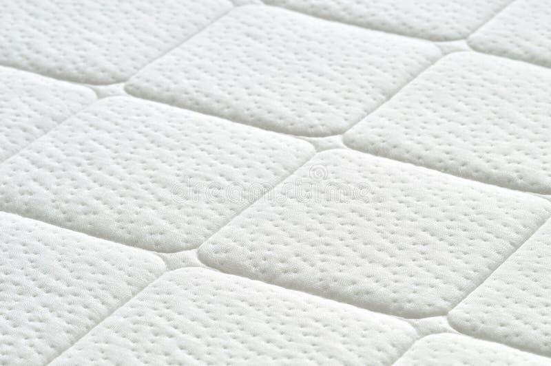 Close-up of white mattress texture. stock photos