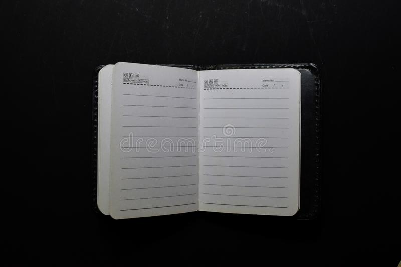 Close up white notebook isolated on black background royalty free stock photos