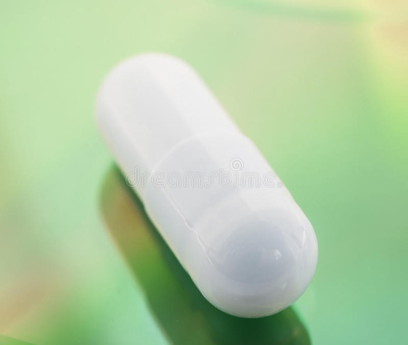 Close up of white pill. royalty free stock image