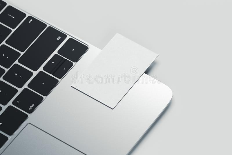 Close up of white realistic modern business card on laptop on light background. 3d rendering. Close up of white realistic modern business card on laptop royalty free illustration