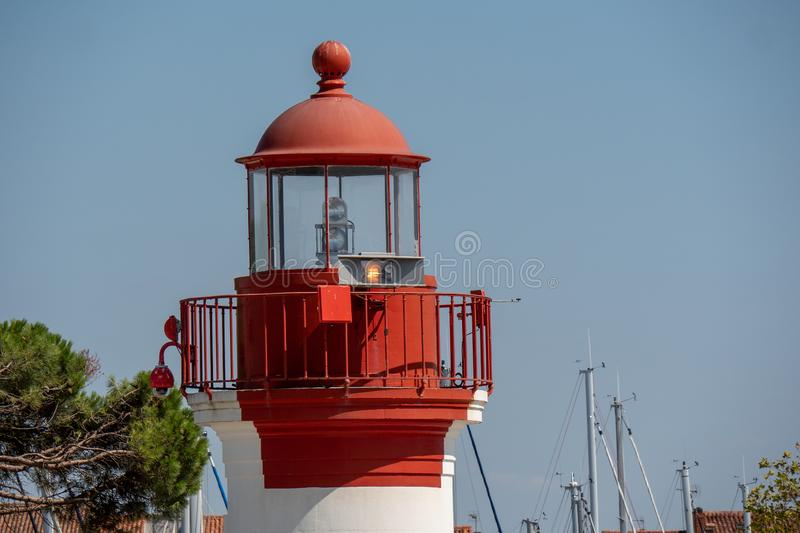 Close up of white and red lighthouse royalty free stock image