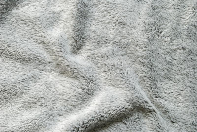 Close up white shaggy artificial fur texture or carpet for background.  stock image