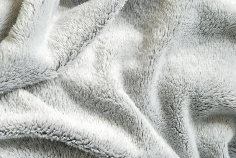 Close up white shaggy artificial fur texture or carpet for background.  royalty free stock image