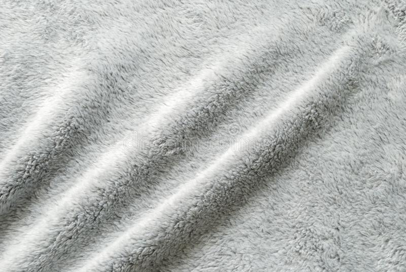 Close up white shaggy artificial fur texture or carpet for background.  stock photos