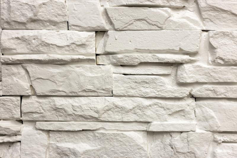 Close-up of white solid limestone wall or stone fence. Abstract copy space background, Bricklaying, construction and masonry. Concept stock images