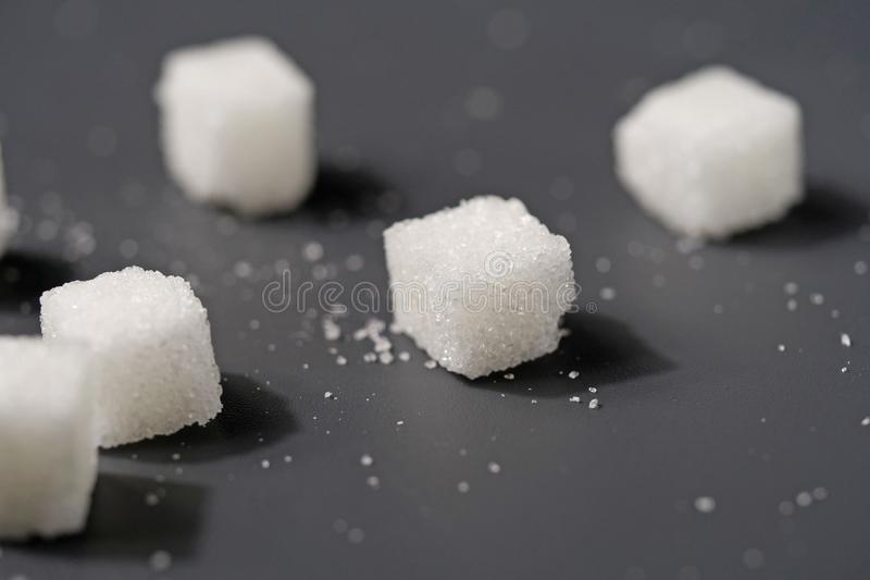 White sugar cubes on black table stock photography
