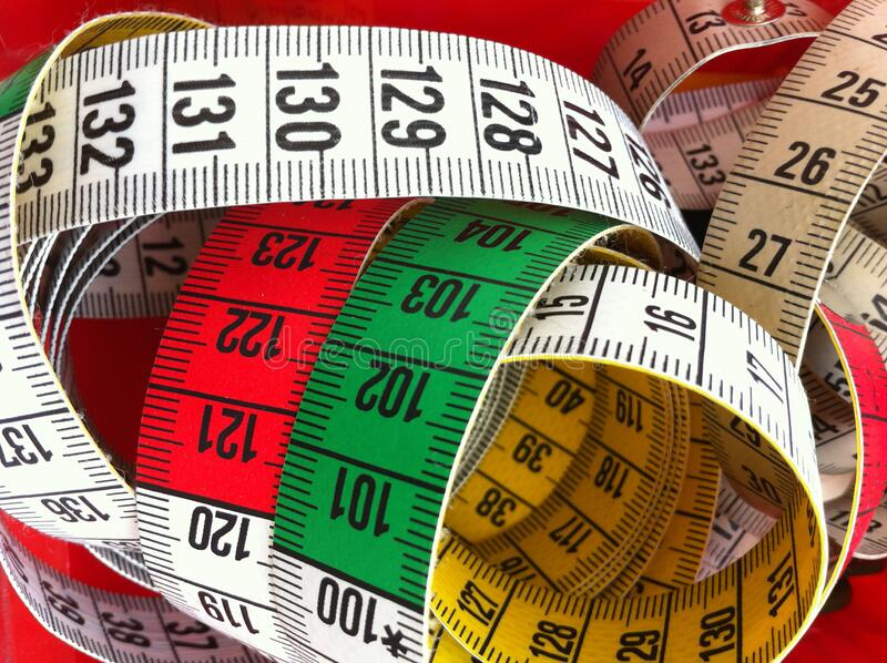 Heap of rolled up tape measure royalty free stock photos