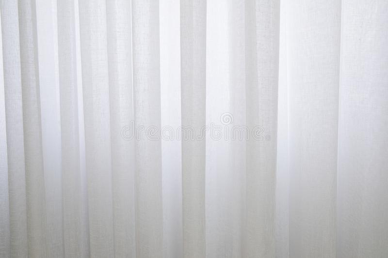 Close up of white tulle curtain background stock photo
