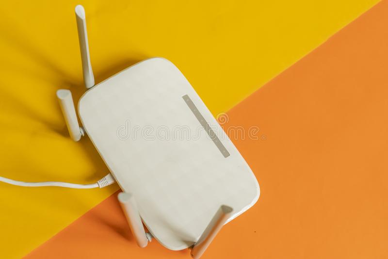Close up white wi-fi router on the color background f royalty free stock images
