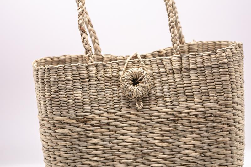 Wickerwork woman bag texture made from dry sedge isolate on white  background.Closeup surface texture of hand made craft work papy. Close up Wickerwork woman bag stock photos