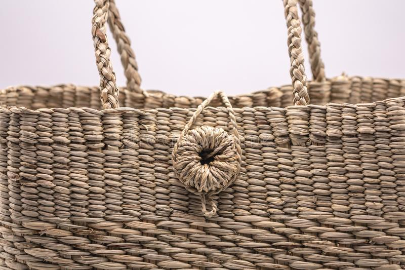 Wickerwork woman bag texture made from dry sedge isolate on white  background.Closeup surface texture of hand made craft work papy. Close up Wickerwork woman bag stock photography
