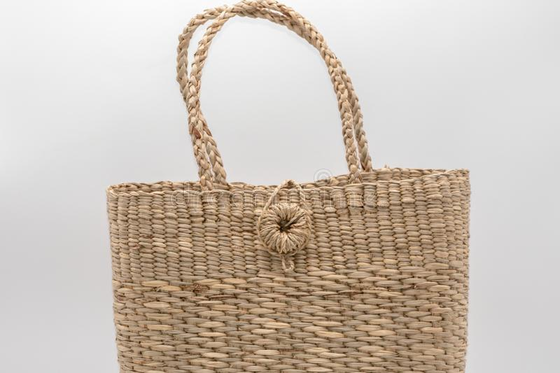 Wickerwork woman bag texture made from dry sedge isolate on white  background.Closeup surface texture of hand made craft work papy. Close up Wickerwork woman bag royalty free stock photo