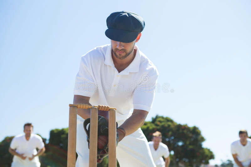 Close up of wicket keeper standing by stumps royalty free stock photography