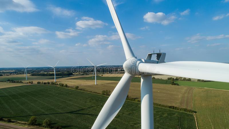 Windfarm in Horizon. Close-up of Wind Turbine - Windfarm in Horizon royalty free stock photos