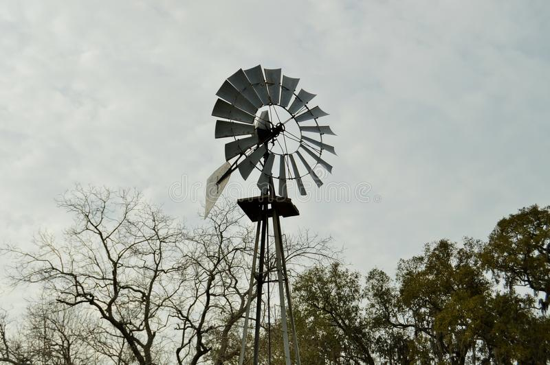 Close-up of windmill against sky. Close-up of a windmill against a cloudy sky stock image
