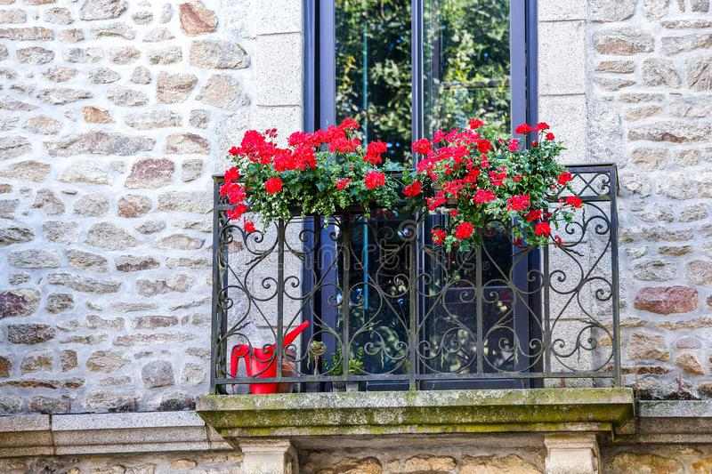 Window with flowers in the balcony royalty free stock photo