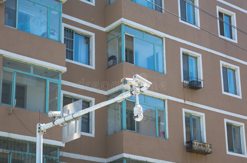 Close up on windows of appartment building and traffic cameras stock photos
