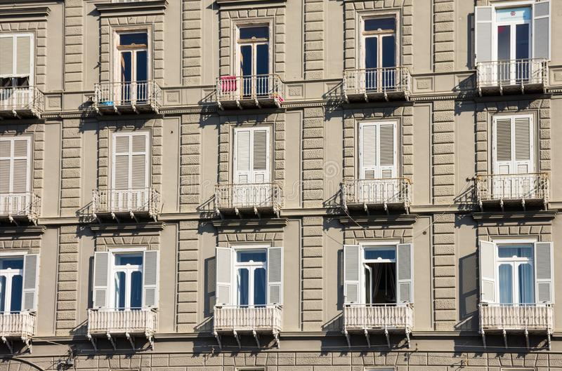 Close up windows with wooden shutters in an Italian traditional building in the center of Naples, Italy stock photo