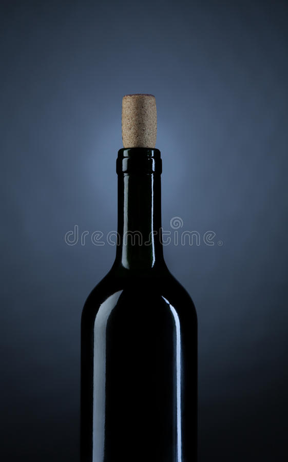 Close up Wine bottle on dark studio background. Photo royalty free stock photography
